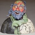 front view of ceramics sculpture of homeless man