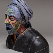 ceramics sculpture of weather beaten homeless lady