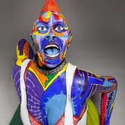 front view of ceramic sculpture of punk chick with colorful surface decoration