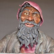 ceramics sculpture of homeless man squinting in the sunlight